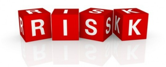 Image of lettered building blocks spelling the word RISK
